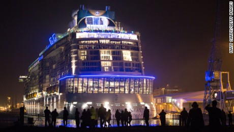 People gather to see the cruise ship Quantum of the Seas which is currently docked at Southampton on October 31, 2014 in Southampton, England. Billed as the world's first smartship, Royal Caribbean's Quantum of the Seas is claimed to be the most high-tech cruise ship in the world, with high tech modifications such as virtual balconies in windowless rooms and features such as the first dodgem ride on water, and a skydiving simulator. The ship will shortly begin its voyage from Southampton, where it docked earlier this week, to New York before relocating to the Caribbean for the 2014-15 season. (Photo by Matt Cardy/Getty Images)