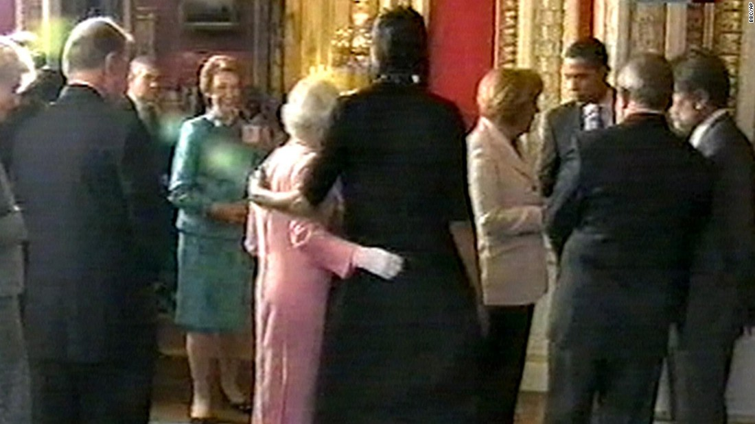 Michelle Obama, center right, stands with her arm around Britain's Queen Elizabeth II during a reception at Buckingham Palace. It's a royal no-no to touch the queen, but if anyone can get away with it, the first lady can.