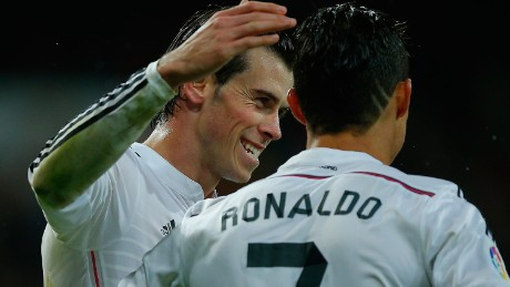 Cristiano Ronaldo (R) of Real Madrid CF celebrates scoring their fifth goal with teammate Gareth Bale (L) during the La Liga match between Real Madrid CF and Rayo Vallecano de Madrid at Estadio Santiago Bernabeu on November 8, 2014 in Madrid, Spain. (Photo by Gonzalo Arroyo Moreno/Getty Images)