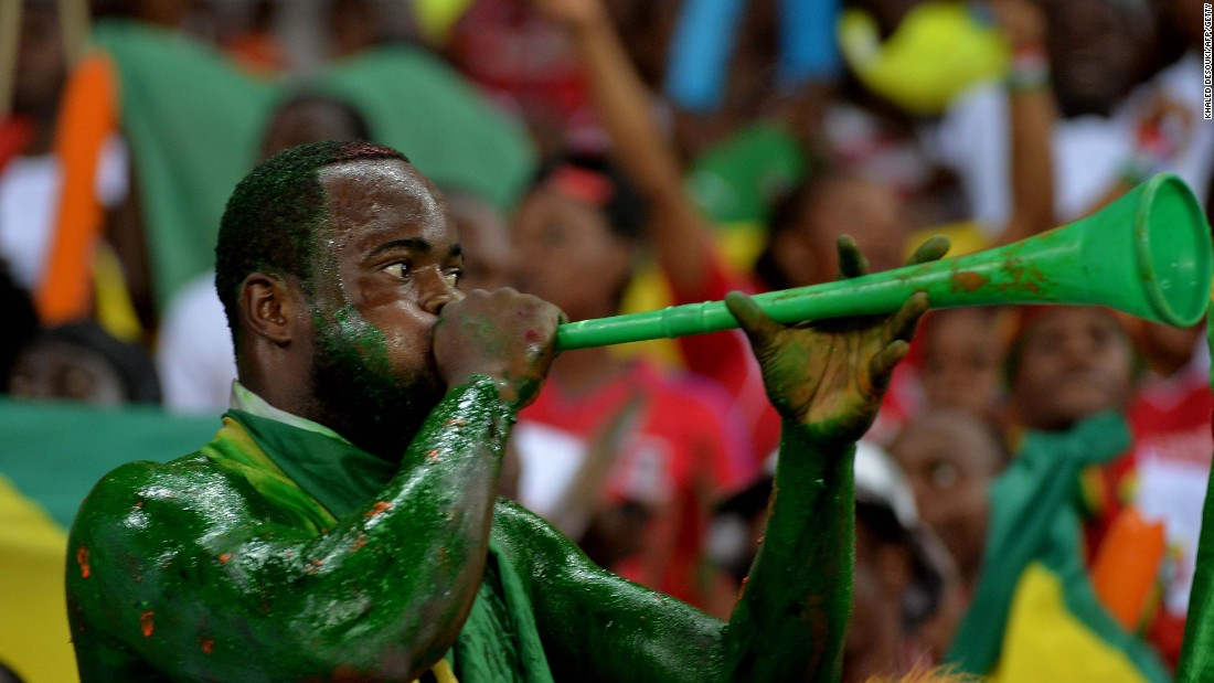 A Congo fan trumpets his support for his team as it beats Gabon 1-0 in a Group A qualifier.
