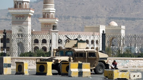 A Shiite Huthi militiaman sits near a tank confiscated from the army in the area around the presidential palace in the capital Sanaa, on January 22.