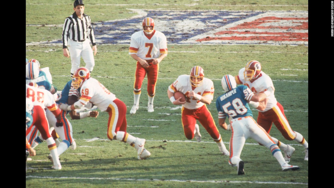Washington running back John Riggins bursts through a hole during the Redskins' 27-17 victory over Miami in Super Bowl XVII. Riggins was named MVP after rushing for 166 yards and a touchdown.