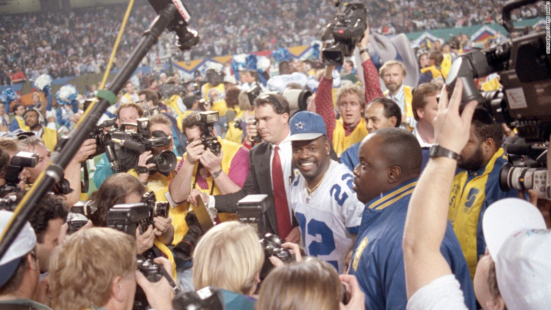 Dallas running back Emmitt Smith is surrounded by the media after his MVP performance against Buffalo in Super Bowl XXVIII. Smith rushed for 132 yards and three touchdowns as Dallas won 30-13 in a Super Bowl rematch from one year earlier.