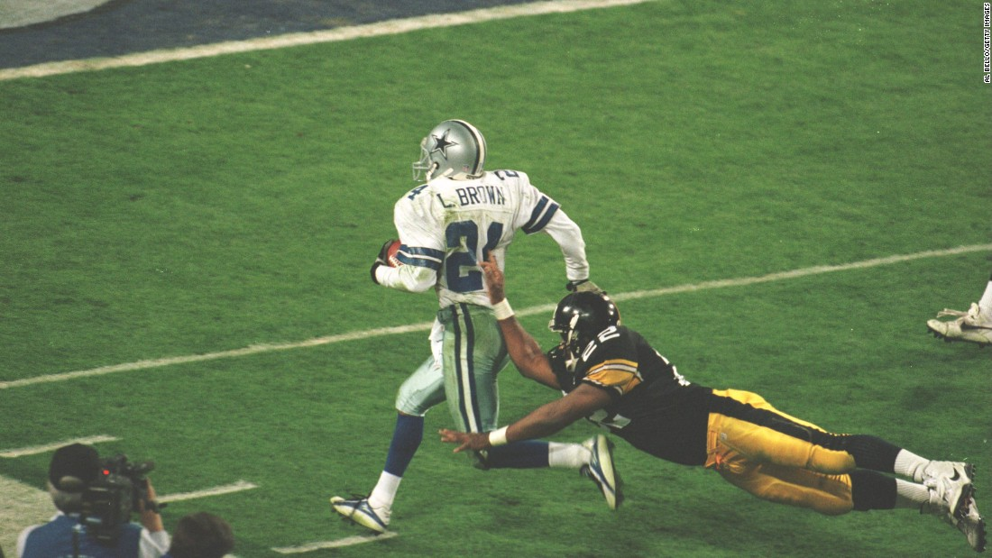 Dallas Cowboys cornerback Larry Brown is pushed out of bounds after one of his two interceptions in Super Bowl XXX. Brown's MVP efforts helped the Cowboys beat Pittsburgh 27-17 for their third championship in four years.
