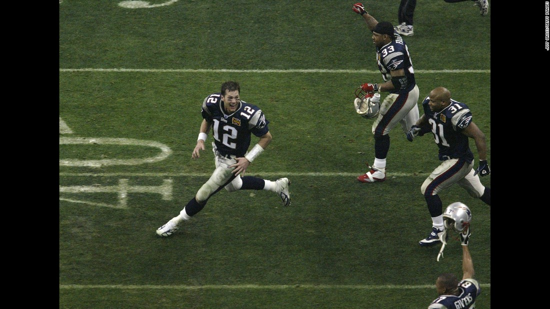 New England quarterback Tom Brady, left, celebrates with teammates after winning a second Super Bowl in three years. Brady was MVP again, throwing for 354 yards and three touchdowns as the Patriots defeated the Carolina Panthers 32-29.