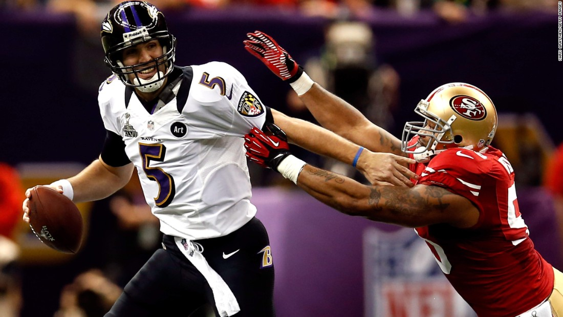Baltimore Ravens quarterback Joe Flacco fights off San Francisco linebacker Ahmad Brooks during Super Bowl XLVII, which the Ravens won 34-31. Flacco had 287 yards and three touchdowns in a game that was interrupted for 34 minutes because of a power outage.