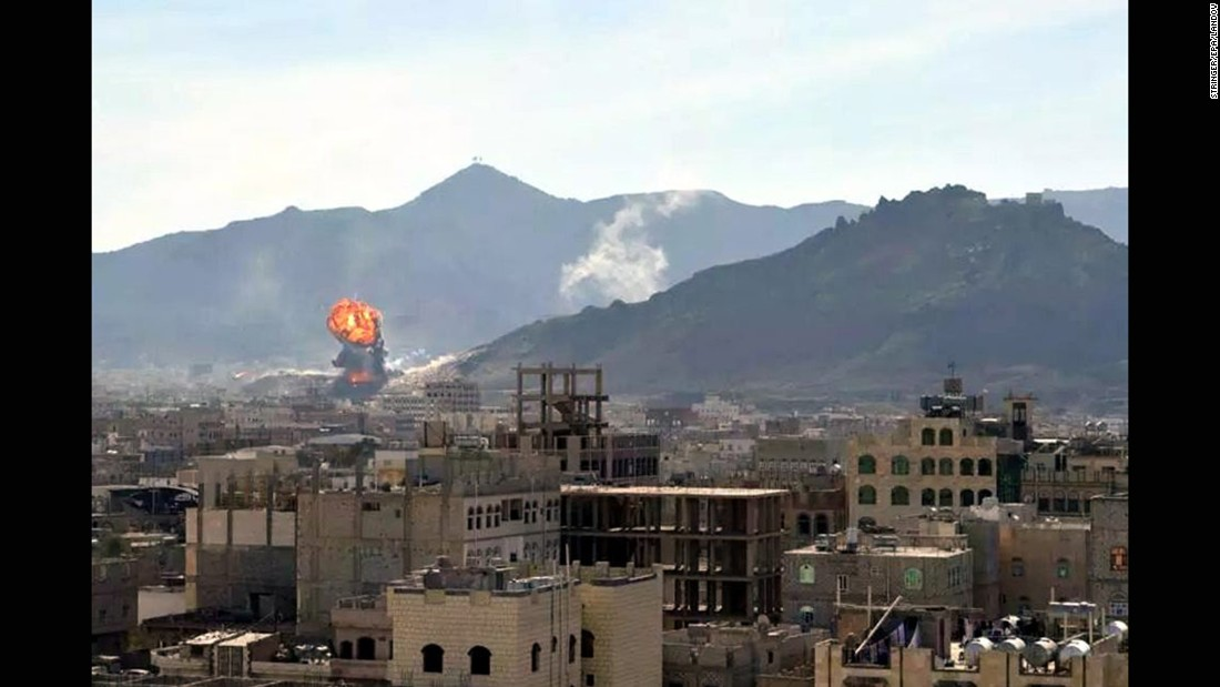Smoke and flames rise in Sanaa, Yemen, during heavy clashes between presidential guards and Houthi rebels on Monday, January 19. Yemeni President Abdu Rabu Mansour Hadi, Prime Minister Khaled Bahah and the country's Cabinet resigned several days later.