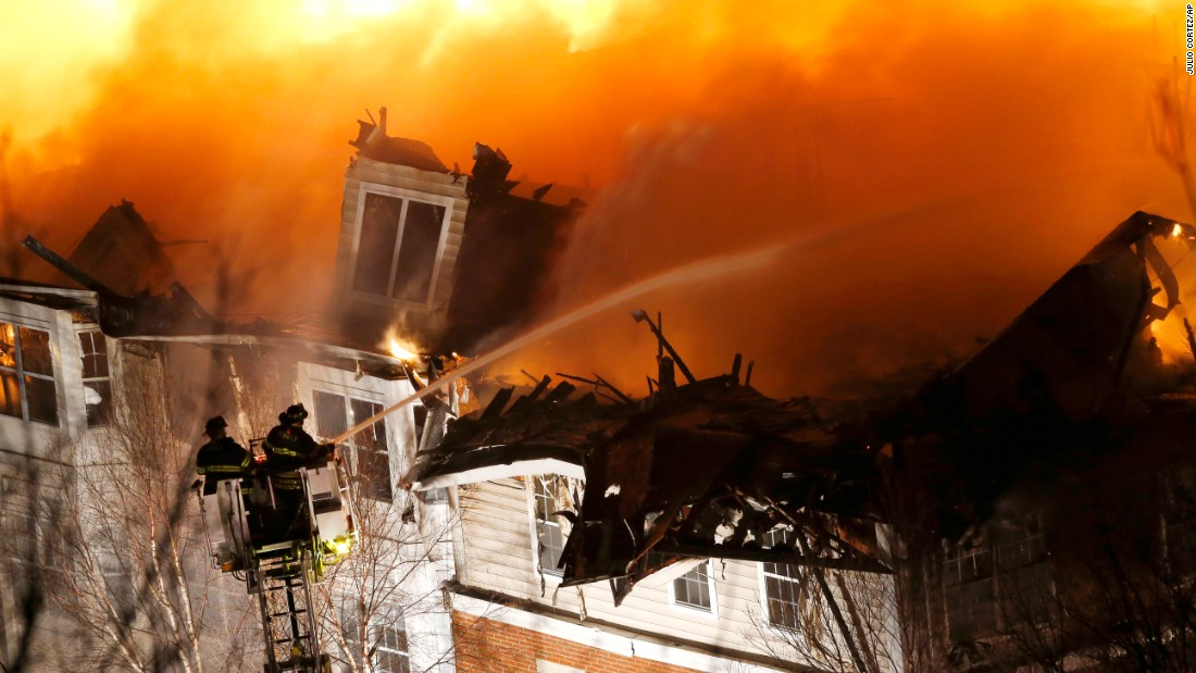 "Firefighters stand on a ladder while spraying water onto an apartment complex in Edgewater, New Jersey, on Wednesday, January 21. The fire <a href=""http://www.cnn.com/2015/01/22/us/new-jersey-apartment-fire/index.html"" target=""_blank"">consumed 240 apartments</a> and permanently displaced up to 500 residents, according to Edgewater Mayor Michael McPartland."