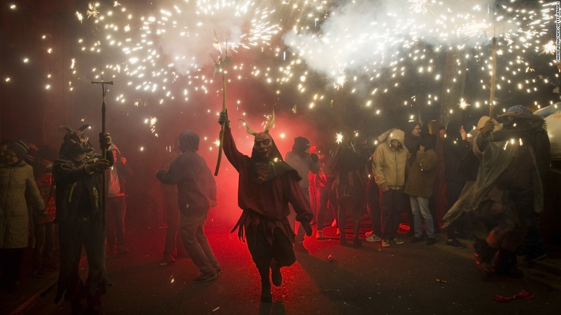 A reveler wearing a demon costume takes part in the traditional Correfoc festival in Palma de Mallorca, Spain, on Saturday, January 17. During the Correfoc, participants dress as demons and devils and move through the streets scaring people with fire and fireworks.