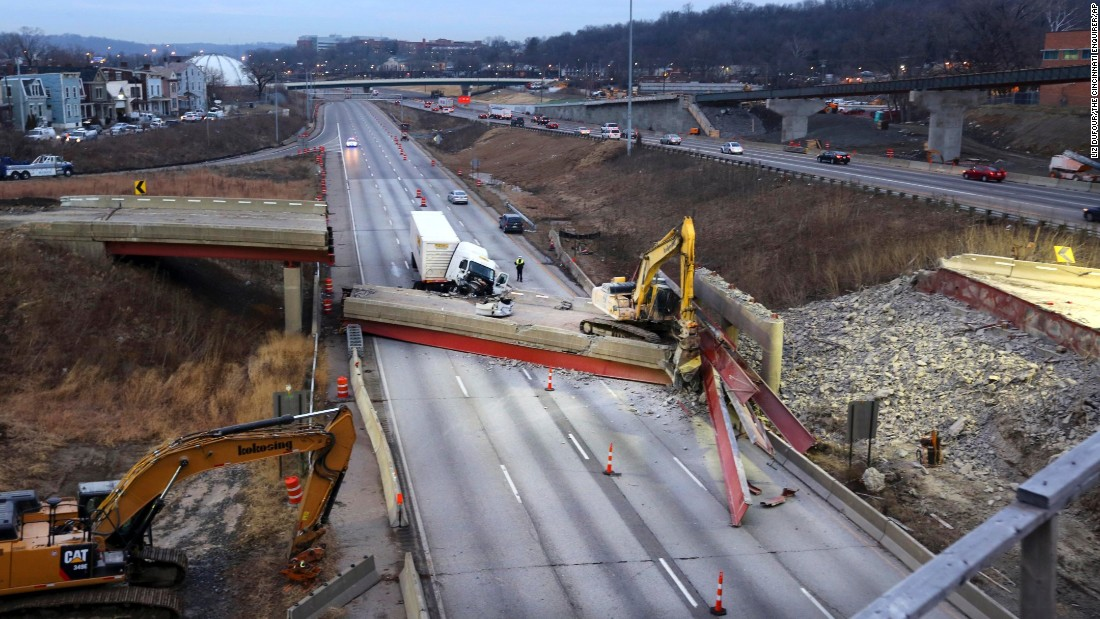 "Work continues Tuesday, January 20, after several hundred tons of concrete fell from an overpass and crashed onto Interstate 75 in Cincinnati. The <a href=""http://www.cnn.com/2015/01/20/us/ohio-overpass-collapse/index.html"" target=""_blank"">""catastrophic pancake collapse""</a> occurred the night before as workers were preparing for the demolition of the overpass, the Cincinnati Fire Department said. The collapse killed a worker and injured a truck driver."