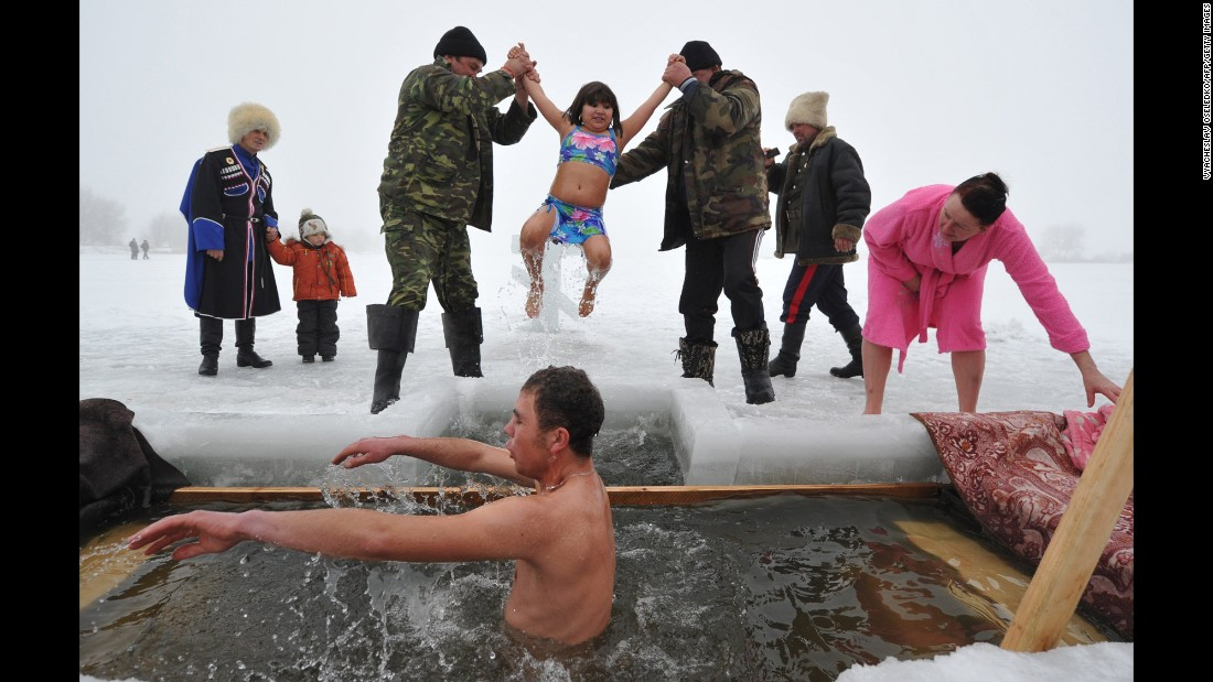 Orthodox Christians near the village of Sretenka, Kyrgyzstan, dip into the icy waters of a lake while celebrating the Epiphany holiday on Monday, January 19. Among Orthodox Christians, the feast of Epiphany celebrates the day the spirit of God descended upon believers in the shape of a dove during Jesus Christ's baptism in the river Jordan.