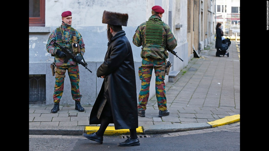 "Belgian paratroopers keep guard outside a Jewish school in Antwerp, Belgium, on Saturday, January 17. Security was tightened in many parts of the country after an <a href=""http://www.cnn.com/2015/01/15/world/gallery/belgium-anti-terror-operation/index.html"" target=""_blank"">anti-terror operation</a> in the city of Verviers on January 15."