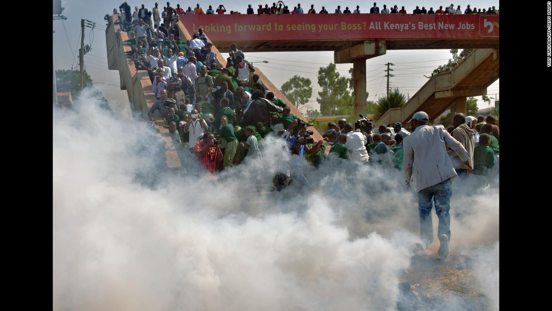 "Children from the Langata Road Primary School scramble up a bridge to escape tear gas after <a href=""http://www.cnn.com/2015/01/20/africa/kenya-playground-children-tear-gassed/index.html"" target=""_blank"">police attempted to break up a demonstration</a> Monday, January 19, in Nairobi, Kenya. The children were among those protesting against the removal of the school's playground."