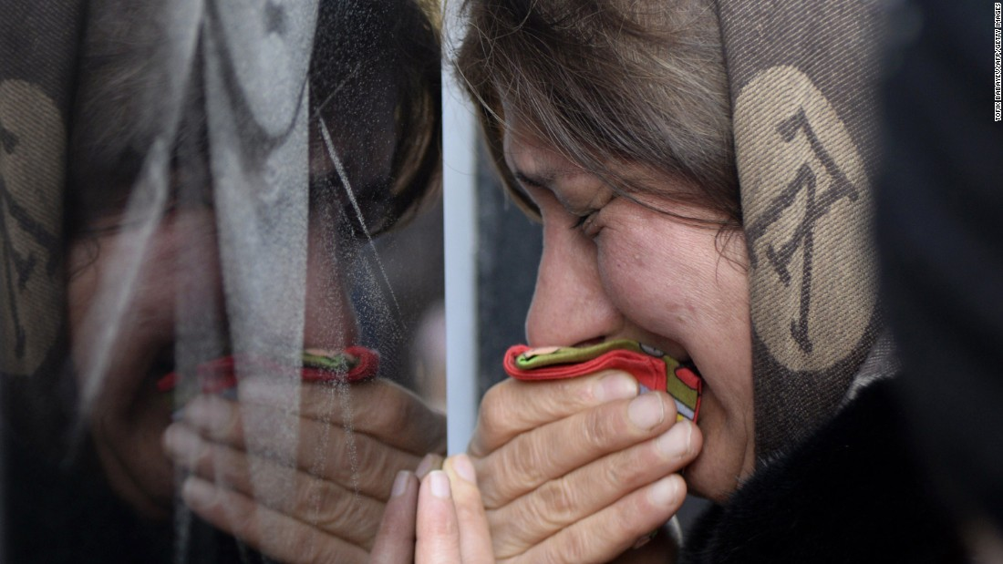 A woman in Baku, Azerbaijan, cries Tuesday, January 20, at the Alley of Martyrs, a cemetery and memorial dedicated to those killed by Soviet troops during the Black January crackdown in 1990.