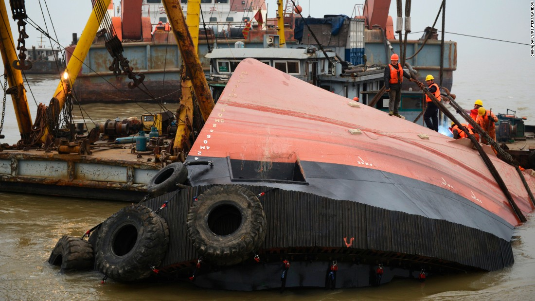 "Rescue workers in Jingjiang, China, gather at a tugboat that <a href=""http://www.cnn.com/2015/01/16/world/yangtze-river-tug-boat-sinking/index.html"" target=""_blank"">sank in the Yangtze River</a> on Thursday, January 15. At least 21 people died and one more was missing, state media reported."