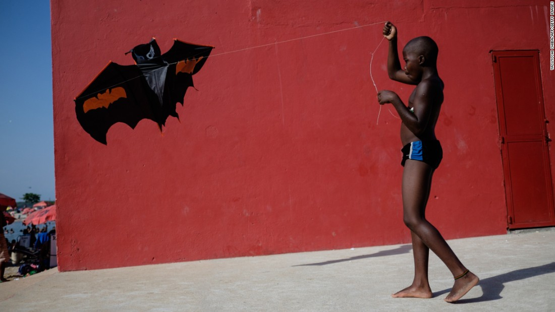 A boy plays with a kite at the Ramos Pool, an artificial beach in Rio de Janeiro, as temperatures reached 45 degrees Celsius (113 degrees Fahrenheit) on Monday, January 19.
