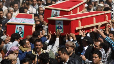 Houthi Shiite Yemeni carry coffins of fellow men killed during recent clashes with presidential guard forces, during their funeral procession in Sanaa, Yemen, January 23, 2015.