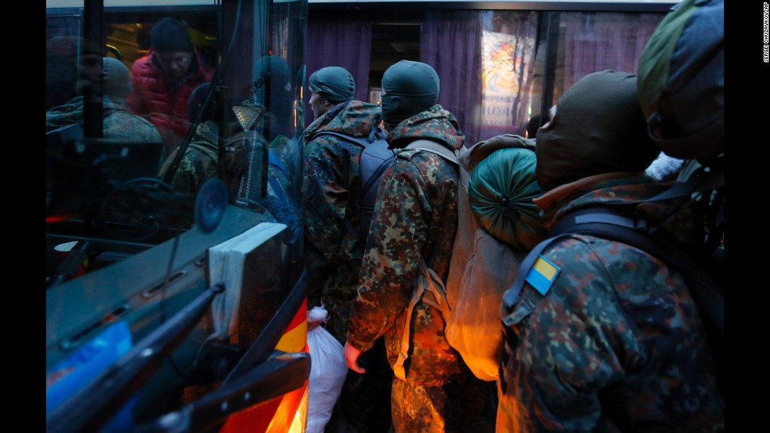 Men from the Azov Volunteer Battalion board a bus in Kiev to join the fight against the rebels on Saturday, January 17.