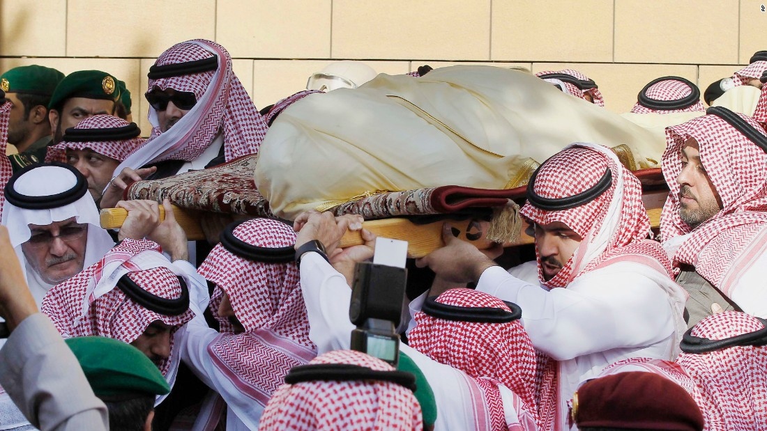 Mourners carry the King's body outside a mosque in Riyadh on January 23.