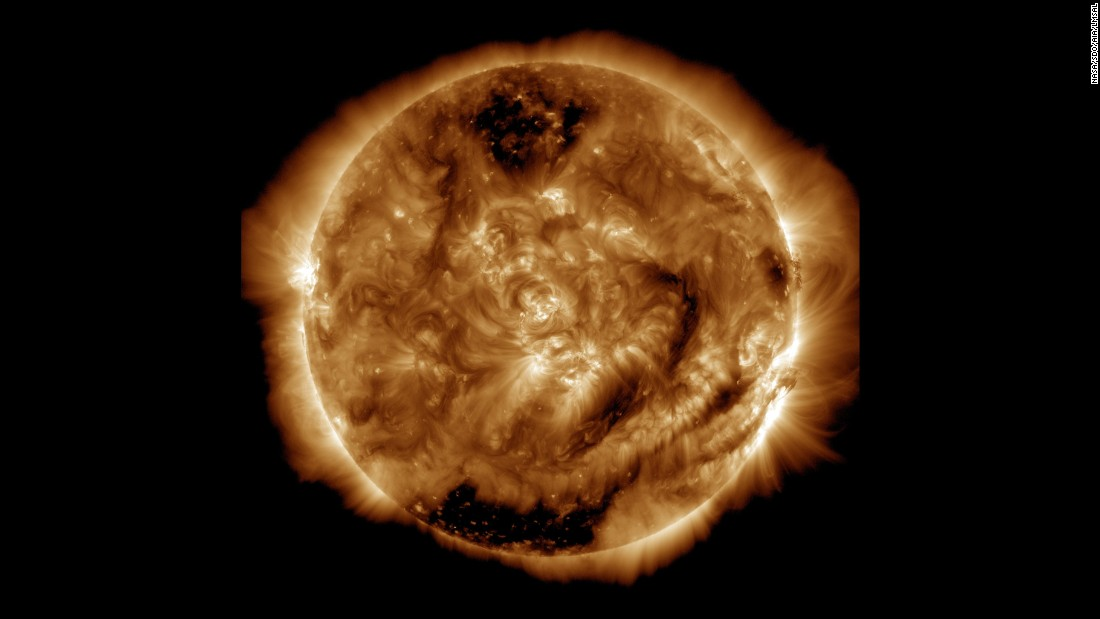 We also saw the 100 millionth image of the Sun taken at NASA's Solar Dynamics Observatory on January 19, 2015. The image's darker regions are areas of less dense gas known as coronal holes, where solar material is moving away from the Sun.