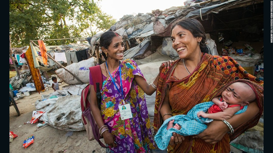 An ASHA worker visits the Chandan slum to discuss general health concerns and family planning practices with residents in Uttar Pradesh, India, on June 4, 2014.