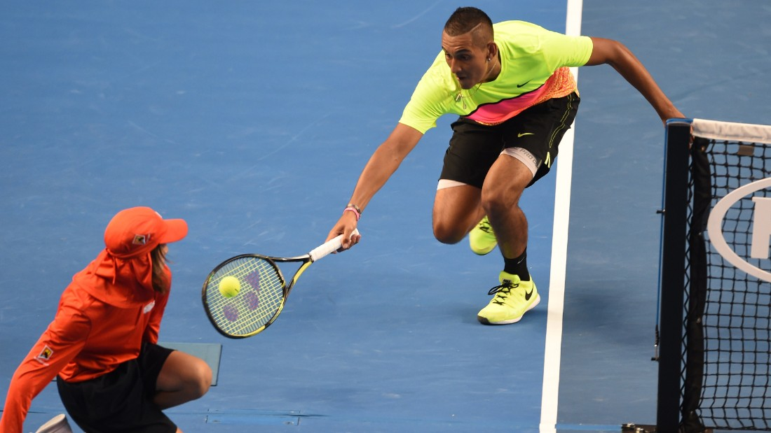 Kyrgios of Australia gets up close and personal with a ball boy during epic win against Seppi.