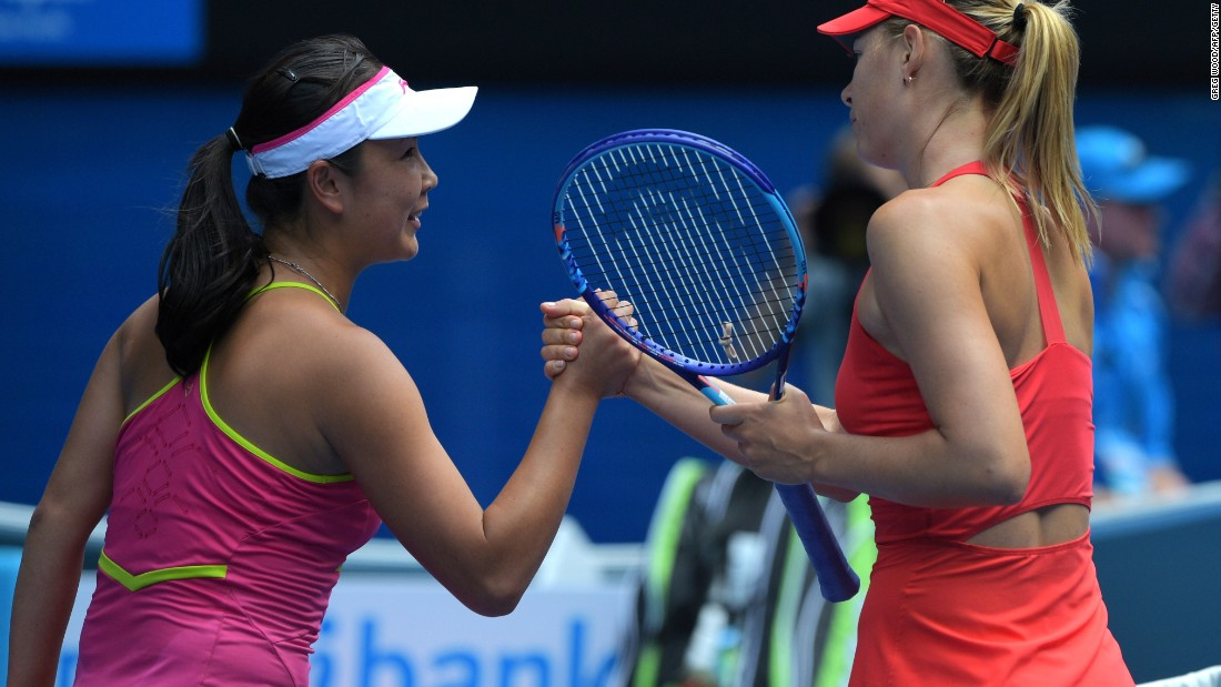 Peng Shuia of China shakes hands with Maria Sharapova after being brushed aside by the Russian second seed in their last 16 clash.