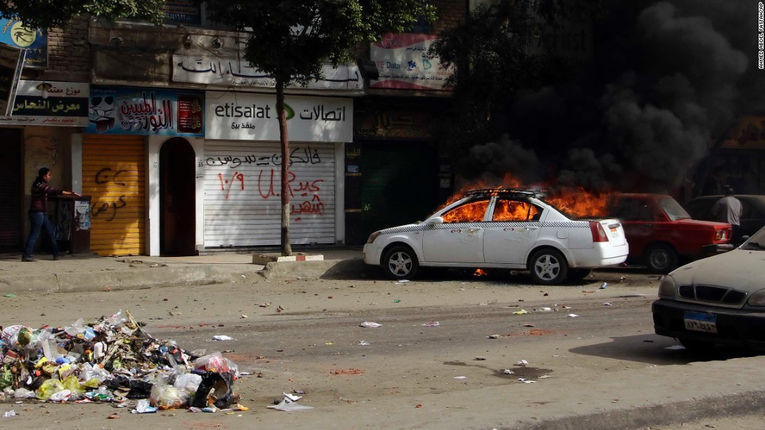 A taxi burns during clashes in the Cairo suburb of Matariyah on January 25.