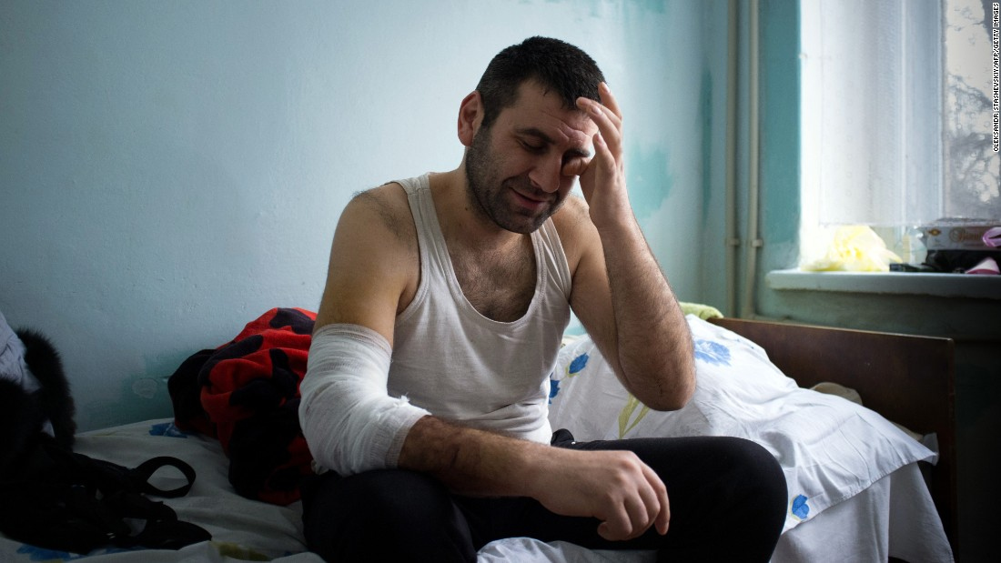 A man injured during shelling in Mariupol sits in an emergency hospital on January 26.