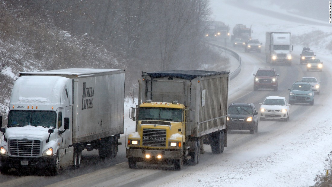 Traffic moves through falling snow near Evans City, Pennsylvania, on January 26.