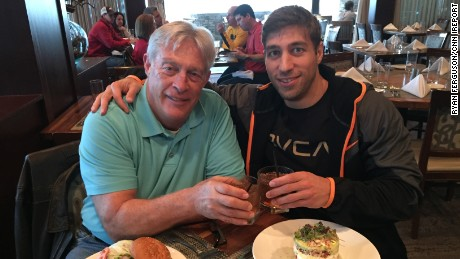 Ferguson and his dad toast on their trip to Atlanta for the 2014 SEC championship game.