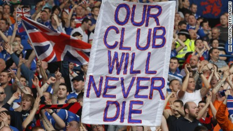Rangers fans display a banner declaring their club will live on despite administration followed by liquidation in 2012.