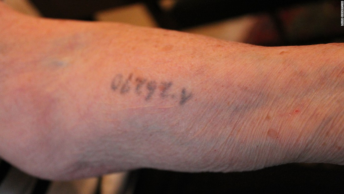 Rozalia shows the tattoo that still remains on her arm from her days at the death camp. Rozalia lost her family and her youth in the Holocaust, but she never lost her will to live.