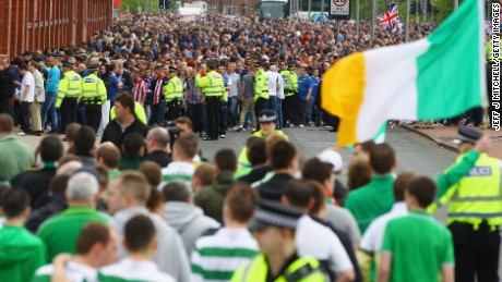 Celtic and Rangers fans are separated by Police outside Ibrox Stadium before an Old Firm fixture in 2011.