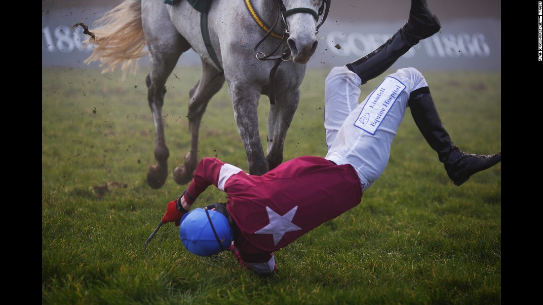 Ger Fox falls from Ipos Du Berlais during a race Thursday, January 22, at Gowran Park Racecourse in Kilkenny, Ireland.
