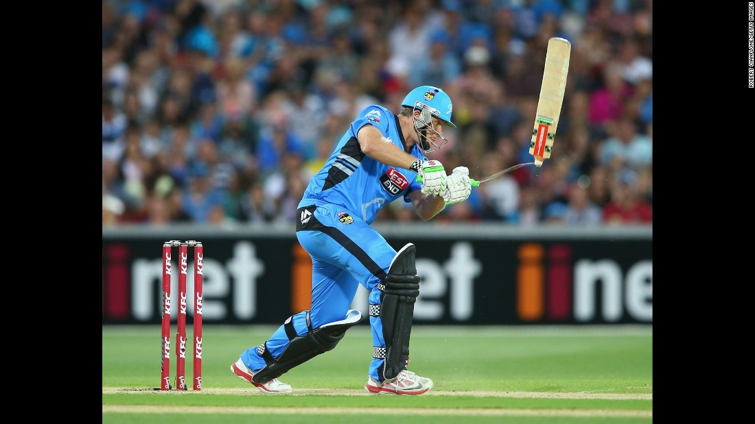 Craig Simmons, a cricketer for the Big Bash League's Adelaide Strikers, breaks his bat as he plays a shot during a league semifinal match Saturday, January 24, in Adelaide, Australia. Adelaide lost to the Sydney Sixers by 87 runs.