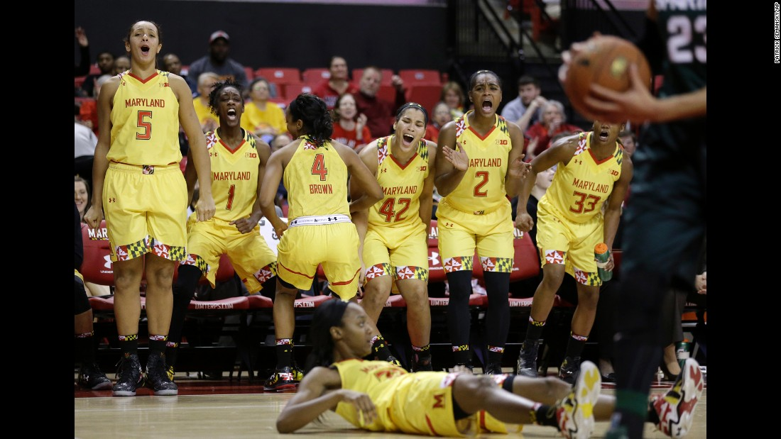 Maryland basketball players celebrate a shot made by Shatori Walker-Kimbrough, bottom, during a home game against Michigan State on Thursday, January 22.