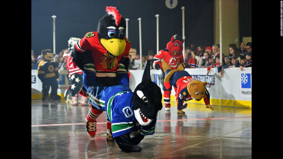 NHL mascots compete in a wheelbarrow race during All-Star Weekend festivities Saturday, January 24, in Columbus, Ohio. In the foreground is the team of Tommy Hawk (Chicago Blackhawks) and Fin the Whale (Vancouver Canucks). At right are N.J. Devil (New Jersey Devils) and Stanley C. Panther (Florida Panthers).