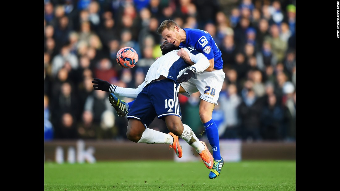 Victor Anichebe of West Bromwich Albion, left, is challenged by Michael Morrison of Birmingham City during an FA Cup match in Birmingham, England, on Saturday, January 24. West Brom won the fourth-round match 2-1 thanks to two goals from Anichebe.