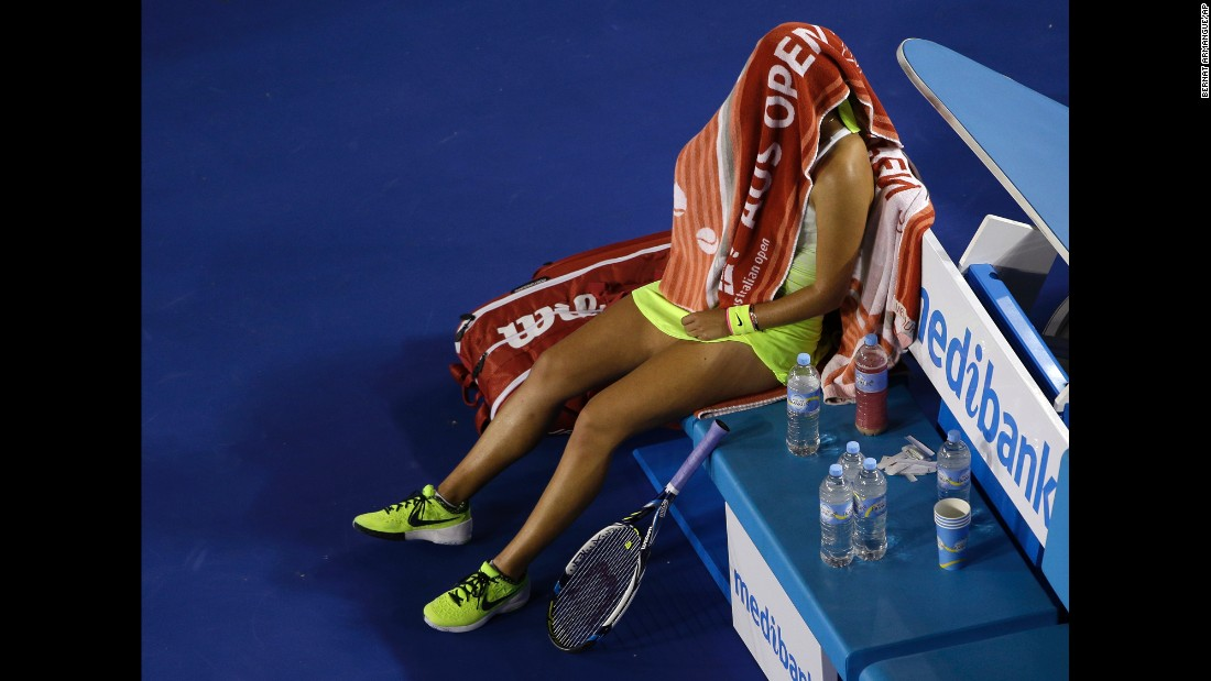 Victoria Azarenka wraps herself in a towel during a break in her Australian Open match against Dominika Cibulkova on Monday, January 26. Cibulkova won in three sets.