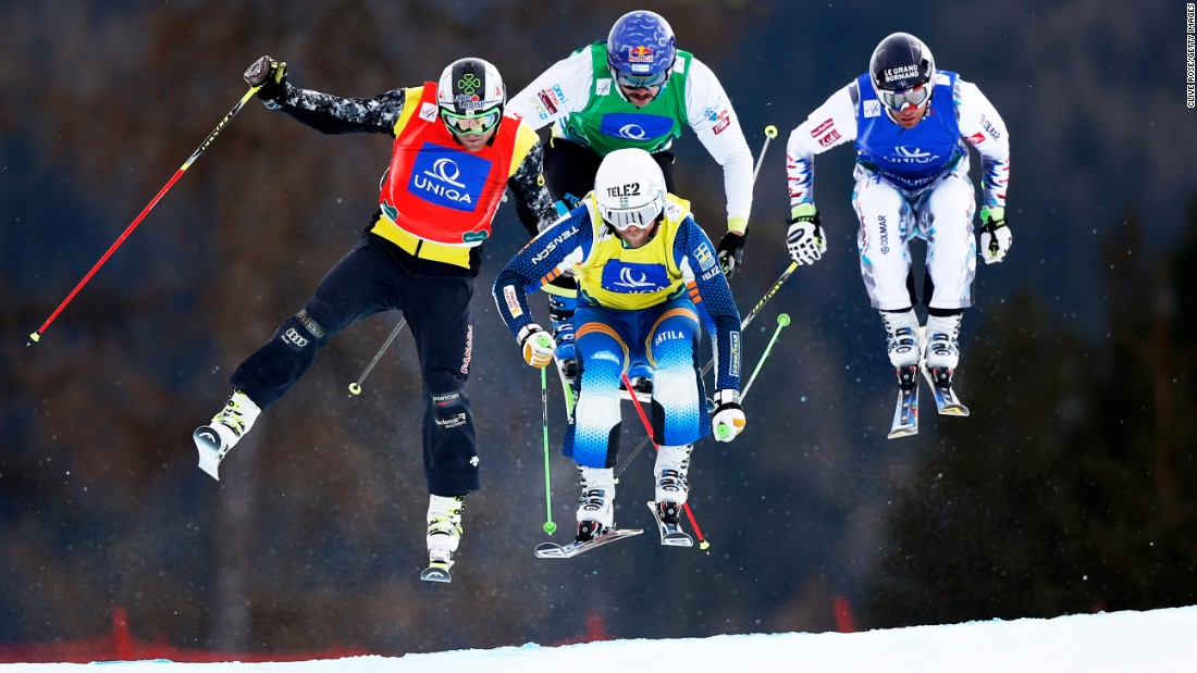 Clockwise from left, Brady Leman, Filip Flisar, Bastien Midol and Michael Forslund compete in a Men's Ski Cross race Sunday, January 25, at the Ski and Snowboard World Championships in Kreischberg, Austria. Flisar, from Slovenia, won gold in the event.