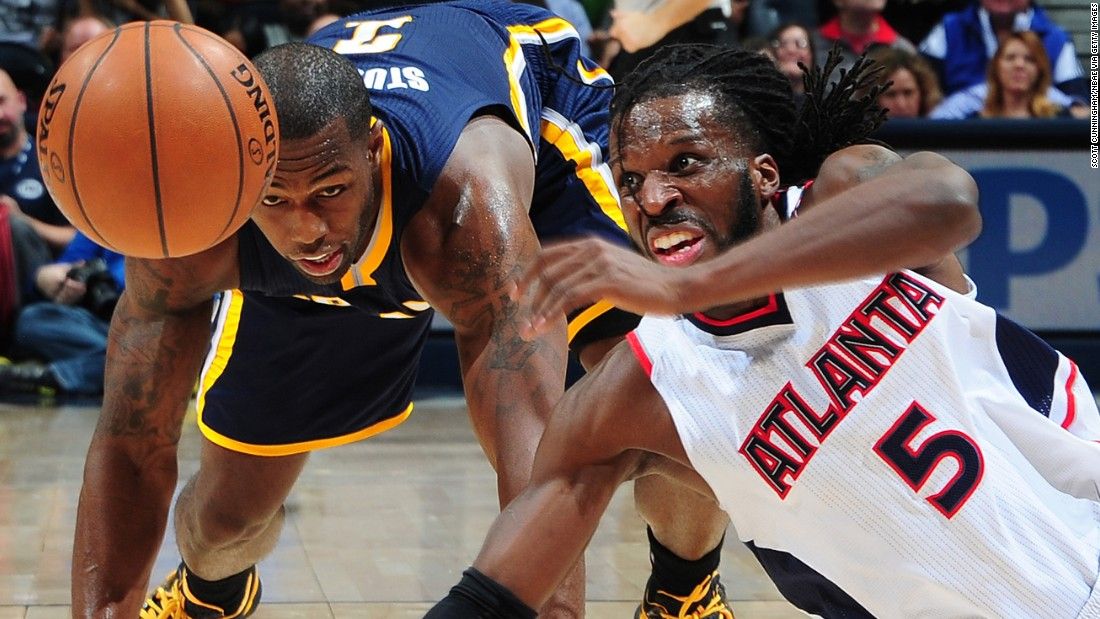 Atlanta's DeMarre Carroll battles Indiana's Rodney Stuckey for a loose ball during an NBA game in Atlanta on Wednesday, January 21.