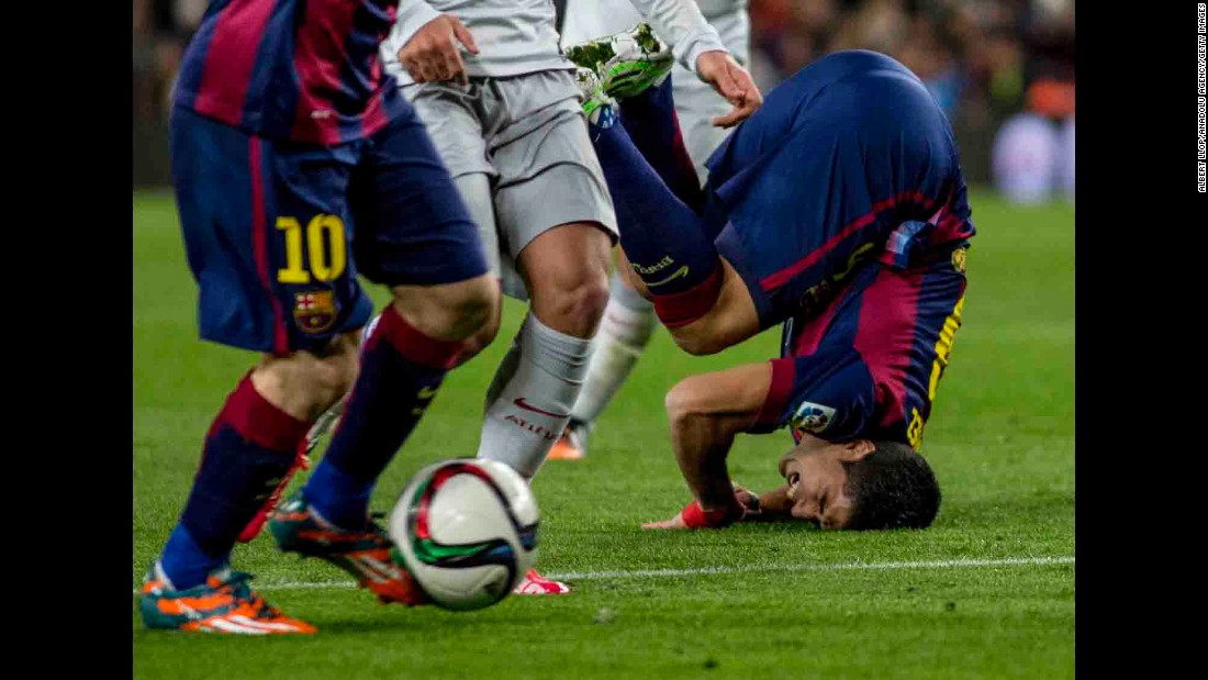 Barcelona's Luis Suarez falls on his face during a Copa del Rey quarterfinal match played Wednesday, January 21, in Barcelona, Spain. Barcelona defeated Atletico Madrid 1-0 in what was the first of a two-legged quarterfinal.