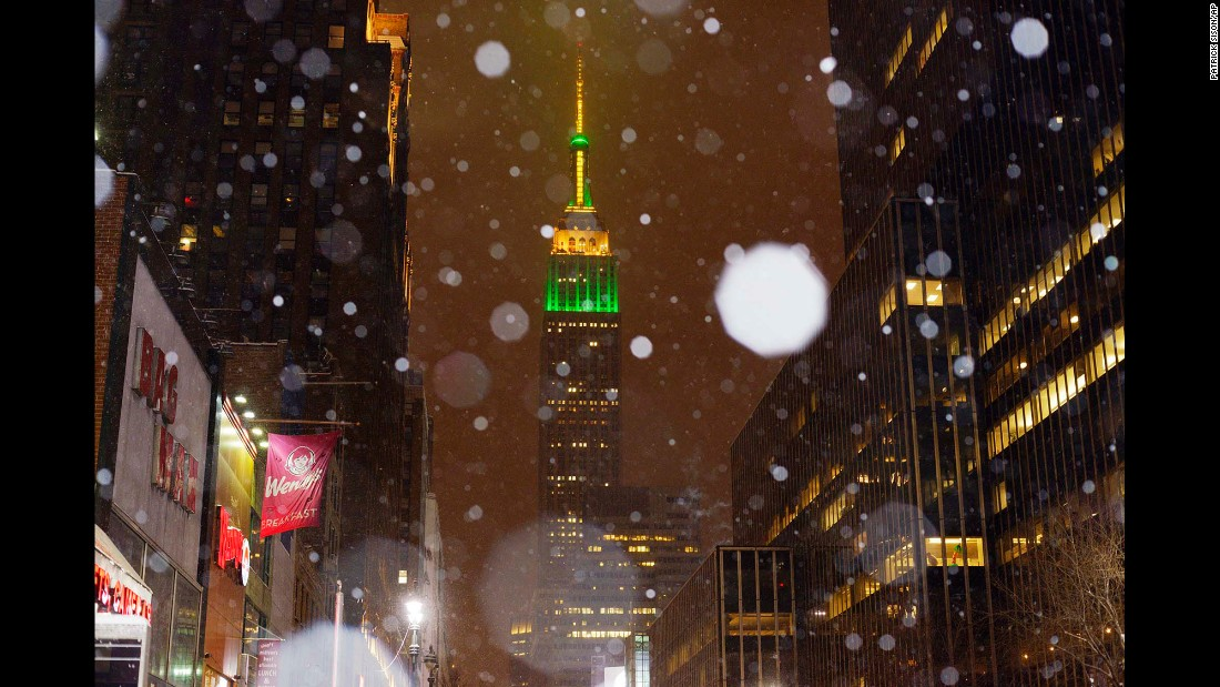 Snow falls around the Empire State Building in New York on January 26.