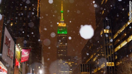 Snow falls around the Empire State Building in midtown Manhattan, on Monday, Jan. 26, 2015, in New York. Tens of millions of people along the Philadelphia-to-Boston corridor rushed to get home and settle in Monday as a fearsome storm swirled in with the potential for hurricane-force winds and 1 to 3 feet of snow that could paralyze the Northeast for days. (AP Photo/Patrick Sison)