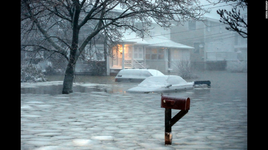 Icy water floods a street in Scituate on January 27.
