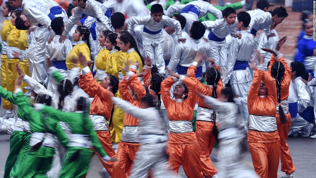 JANUARY 27 - NEW DELHI, INDIA: Dancers perform during India's Republic Day parade. Rain fails to dampen spirits as Barack Obama becomes the first U.S. President to attend the spectacular military and cultural display.