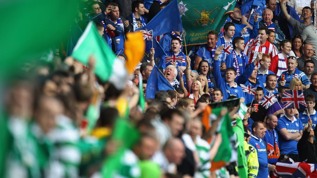 Fans of Celtic and Rangers taunt one another before an Old Firm fixture at Ibrox Stadium in 2011.