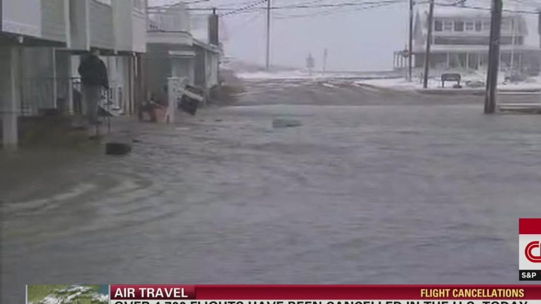Snow keeps falling; flooding hits as New England battles blizzard