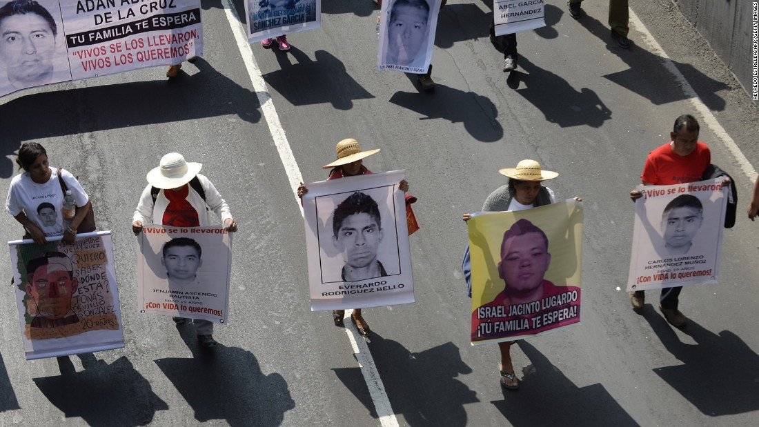 People march January 26 in Mexico City. The students attended Escuela Normal Rural de Ayotzinapa, a rural teachers college known for its political activism.